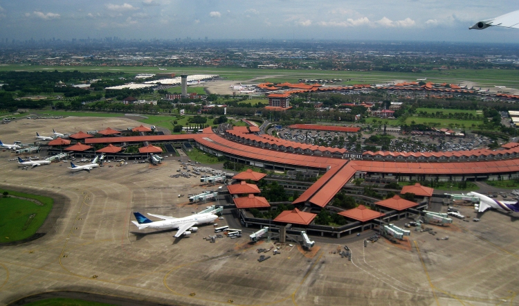 Aerial view of Soekarno-Hatta International Airport, Jakarta (edited horizon). The view taken in 2 January 2010 from Garuda Indonesia airplane during take-off. The architecture reflect Indonesian vernacular architecture of Javanese Joglo roof  with Pendopo as gate lounges (waiting hall) surrounded with tropical gardens.